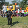 Kristi Garabrandt - The News-Herald<br /> Euclid officer George Panagiotou pushes Za'mier Black, 5, Euclid on the swings during Euclid's National Night Out.