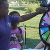 Kristi Garabrandt - The News-Herald<br /> BellaMarie Logan, 11, Euclid spins the wheel for a prize at the Euclid Library table who was set up at Euclid's National Night Out.