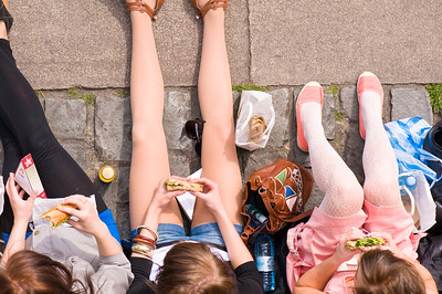 Tourists resting and having lunch by Regents Canal, NW1, Camden Town, London, United Kingdom