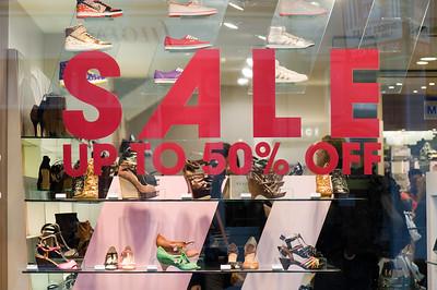 Sale sign in shop window, London, United Kingdom