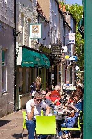 People in busy sidewalk cafe, Richmond, TW10, Surrey, United Kingdom