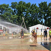 Carol Harper — The Morning Journal <br> Rainbows mirrored the smiles at Kids Water Fights Aug. 5,  2017 at Amherst Fire Department at 414 Church St. in Amherst.