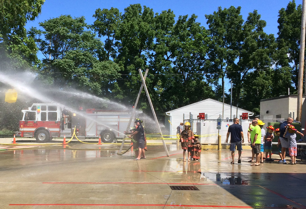 . Carol Harper � The Morning Journal <br> Rainbows mirrored the smiles at Kids Water Fights Aug. 5,  2017 at Amherst Fire Department at 414 Church St. in Amherst.