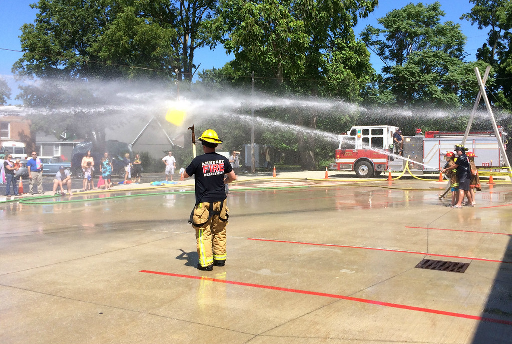 . Carol Harper � The Morning Journal <br> It\'s a blast at Kids Water Fights Aug. 5, 2017, at Amherst Fire Department at 414 Church St. in Amherst.