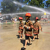 Carol Harper — The Morning Journal <br> Youngsters are suited up and ready for action at Kids Water Fights Aug. 5, 2017, at Amherst Fire Station at 414 Church St. in Amherst.