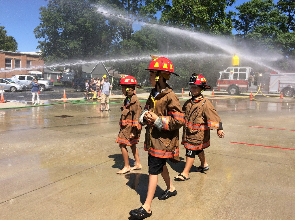 . Carol Harper � The Morning Journal <br> Youngsters are suited up and ready for action at Kids Water Fights Aug. 5, 2017, at Amherst Fire Station at 414 Church St. in Amherst.