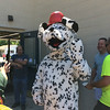 Carol Harper — The Morning Journal <br> Sparky the Fire Dog waves between hugs from children at Kids Water Fights August 5, 2017, at Amherst Fire Department at 414 Church St. in Amherst.