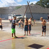 Carol Harper — The Morning Journal <br> Squeals of delight pierced the quiet morning each time competition paused and firefighters blasted a stream of water from the truck at Kids Water Fights Aug. 5, 2017, at Amherst Fire Station at 414 Church St. in Amherst.