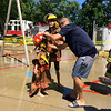 Carol Harper — The Morning Journal <br> They've got the turnout gear at Kids Water Fights Aug. 5, 2017, at Amherst Fire Department at 414 Church St. in Amherst.