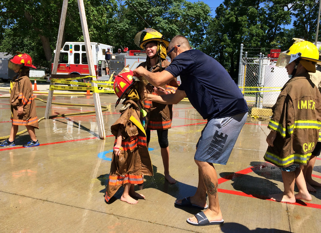 . Carol Harper � The Morning Journal <br> They\'ve got the turnout gear at Kids Water Fights Aug. 5, 2017, at Amherst Fire Department at 414 Church St. in Amherst.