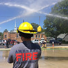Carol Harper — The Morning Journal <br> A battle rages with or without a bucket at Kids Water Fights Aug. 5, 2017 at Amherst Fire Department at 414 Church St. in Amherst.