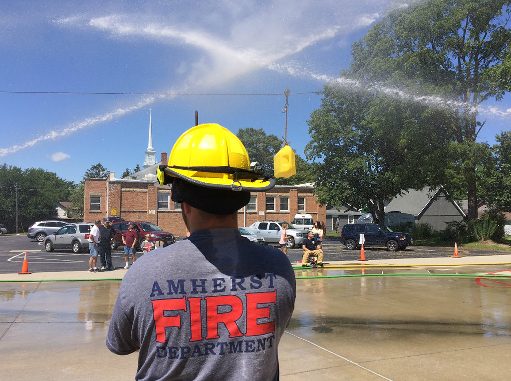 . Carol Harper � The Morning Journal <br> A battle rages with or without a bucket at Kids Water Fights Aug. 5, 2017 at Amherst Fire Department at 414 Church St. in Amherst.