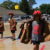 Carol Harper — The Morning Journal <br> Eleven-year-old Brandon Noble, a sixth-grade student at Amherst Junior High, peels off turnout gear revealing an event t-shirt at Kids Water Fights at Amherst Fire Station at 414 Church St. in Amherst.