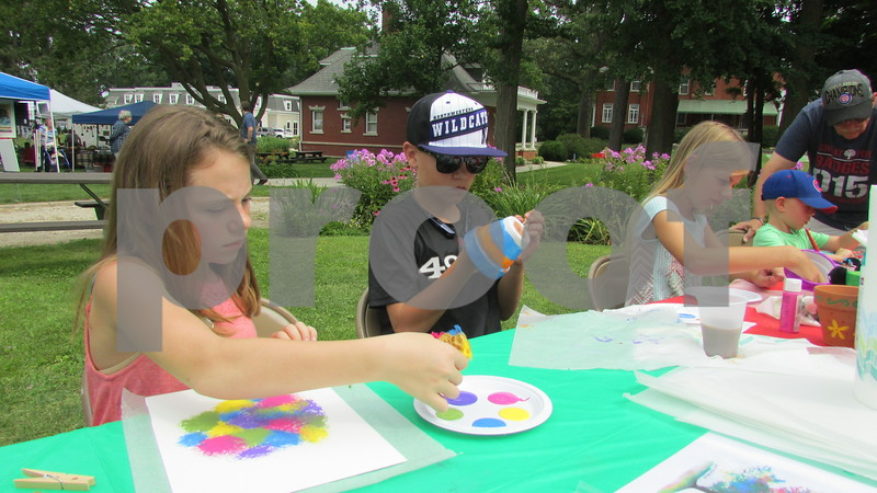 Abbie Andrews, 11, and her brother Asa Andrews, 13, of Genoa and Carly Kammes, 10, of DeKalb create art projects Sunday at the Ellwood House Museum's annual Ellwood Summer Festival.