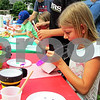 Carly Kammes, 10, of DeKalb paints a ceramic pot Sunday at the Ellwood House Museum's annual Ellwood Summer Festival.