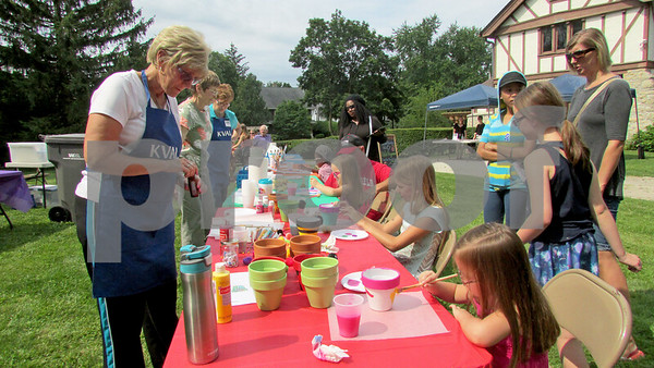 KVAL members assist children with art activities Sunday at the Ellwood House Museum's annual Ellwood Summer Festival.