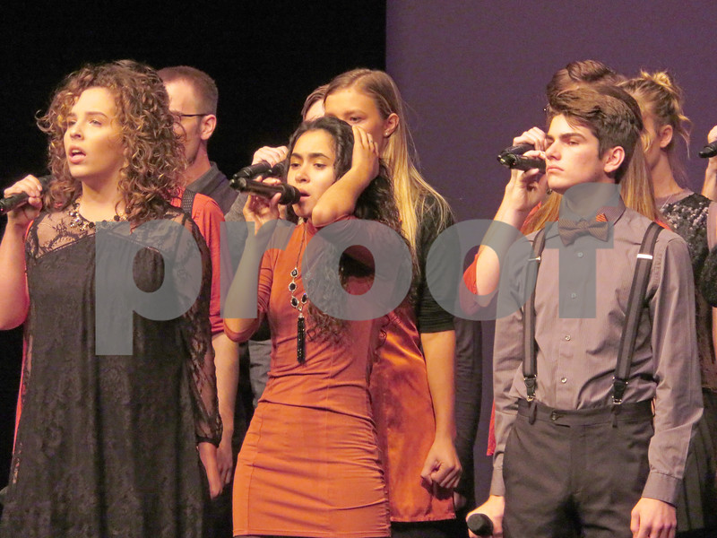From left to right: Grace Klonoski, Destinee Feliciano and Ben Vance perform during a cappella group Enharmonic Fusion's set during the Open Midwest Semifinal Saturday night at DeKalb High School. The majority of the group's members were part of the high school group that won second place during the International Championship of High School A Cappella Finals in April.