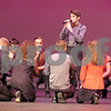 Ben Vance sings one of his solos during a cappella group Enharmonic Fusion's set during the Open Midwest Semifinal Saturday night at DeKalb High School.