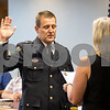 Sam Buckner for Shaw Media.<br /> Sycamore Police Chief Jim Winters takes an oath on Monday August 7, 2017 during the Council meeting.