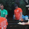 Nickleby's was one of the businesses participating in the event served up free burgers. Patrons grab burgers while drinking beer during the pub crawl. (Kristi Garabrandt/The News-Herald).