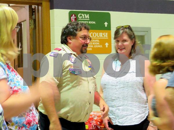 Boy Scout Troop 2 Scoutmaster Jeff Brust walks into his retirement party Monday night at Sycamore United Methodist Church, 160 Johnson Ave., Sycamore.
