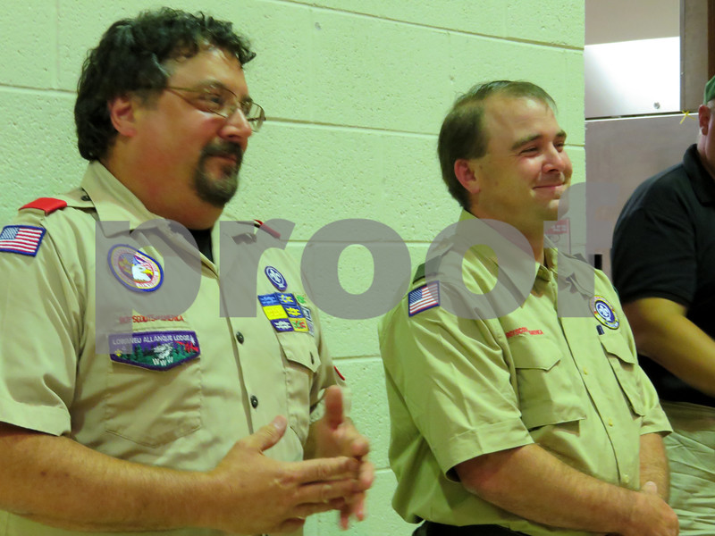 Retiring Boy Scout Troop 2 Scoutmaster Jeff Brust (left) talks with incoming Scoutmaster Brandon Kocher during Brust's retirement party.