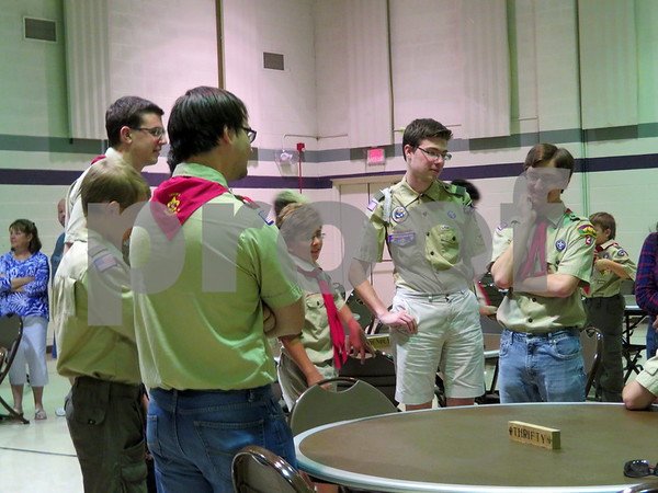 Boy Scouts from Troop 2 in Sycamore talk among themselves during Scoutmaster Jeff Brust's retirement party.