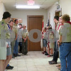 Boy Scouts from Troop 2 in Sycamore line up before they present the colors Monday night during Scoutmaster Jeff Brust's retirement party.