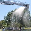 Mentor High School Marching Band battles it out in a shave cream showdown to wrap up Band Camp. Mentor Fire Department was on the scene to hose them down afterwards.  <br /> Kristi Garabrandt - The News-Herald