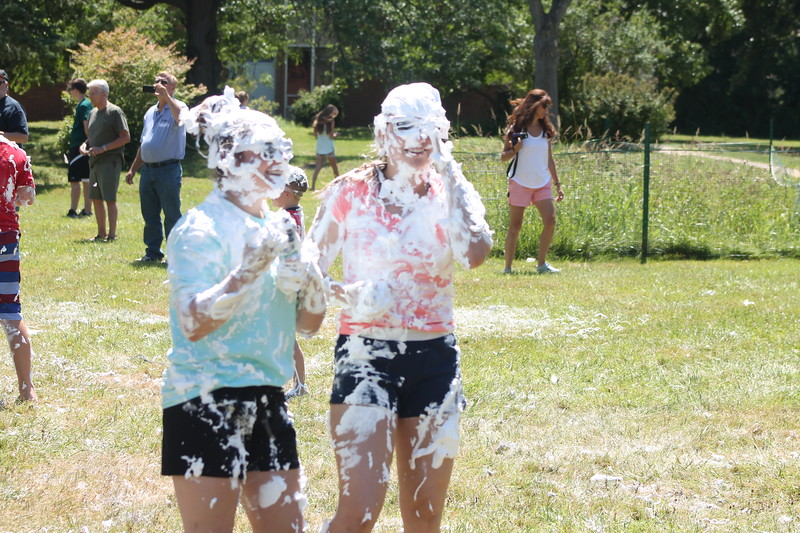 Mentor High School Marching Band battles it out in a shave cream showdown to wrap up Band Camp. Mentor Fire Department was on the scene to hose them down afterwards.  <br /> Kristi Garabrandt - The News-Herald​