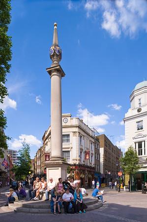 People enjoy warm summer day around Seven Dials, West End, London, United Kingdom