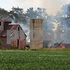 dnews_0809_Barn_Fire_COVER
