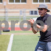 Sam Buckner for Shaw Media.<br /> Assistant coach Phil Rouse pushes his team to keep working hard and to communicate on Wednesday August 9, 2017.
