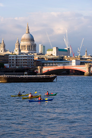 People in kayaks on Thames River by Southbank, London, United Kingdom