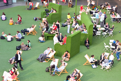 People relax on warm summer day by National Theatre, Southbank, London, United Kingdom