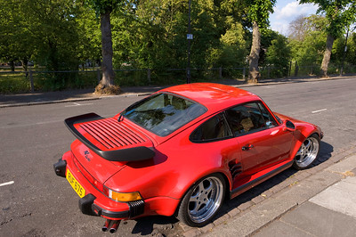 Red Porsche Carrera parked on road, London, United Kingdom