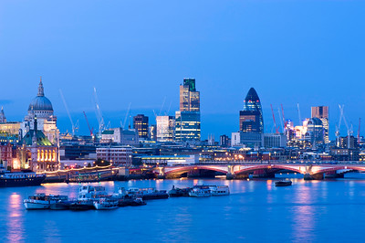 Night view of Thames River and City of London, London, United Kingdom