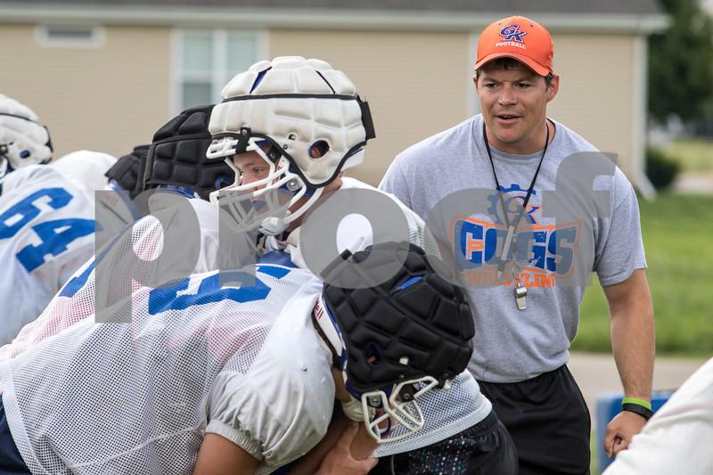 Sam Buckner for Shaw Media.<br /> Head Coach Chad Wilmarth runs blocking drills on Thursday August 10, 2017.