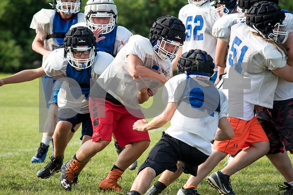 Sam Buckner for Shaw Media.<br /> Jackson Ebel rushes through a group of defense on Thursday August 10, 2017.