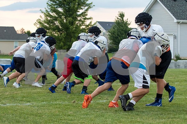 Sam Buckner for Shaw Media.<br /> Lineman work on double team blocking early morning on Thursday August 10, 2017.
