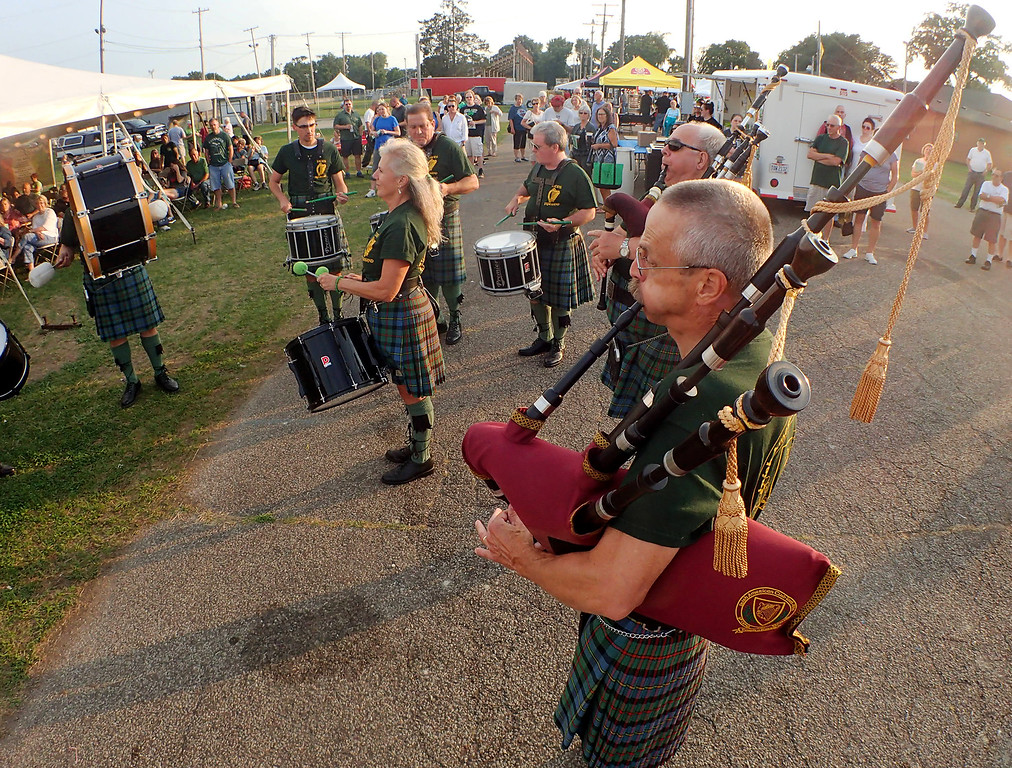 . Jonathan Tressler � The News Herald <br> Members of the East Side Irish American Club Pipes & Drums performs for a crowd near the Murphy�s Irish Stout Stage Aug. 10 during the first day of the Ohio Celtic Festival at Lake County Fairgrounds in Painesville Township.