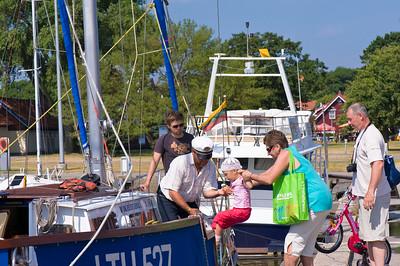 Tourists going on a boat trip, Nida village, Neringa, Lithuania