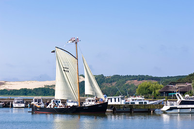 Tourists on sailing trip leaving marina, Nida village, Neringa, Lithuania