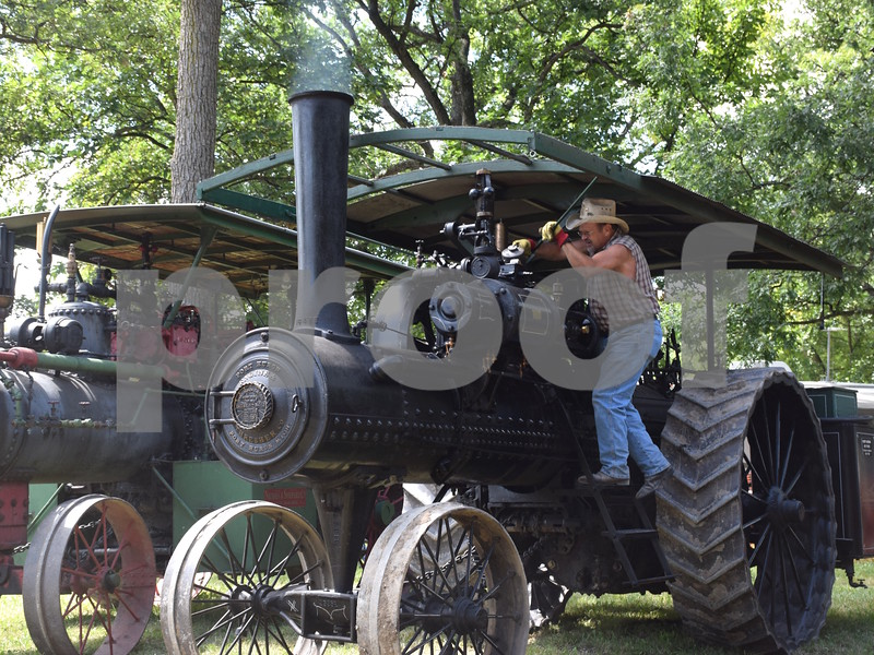 Katrina J.E. Milton - kmilton@shawmedia.com<br /> On Friday, Aug. 11, George McCollum of LaMoille performs maintenance on his 1920 Port Huron steam engine during the 61st annual Sycamore Steam Show and Threshing Bee, held at the Taylor Marshall Farm, 27707 Lukens Road in Sycamore.