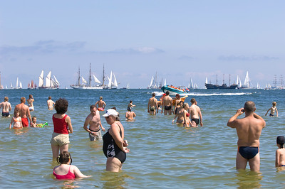 People relax on beach during Tall Ships Race 2009, Baltic Sea, Gdynia, Poland