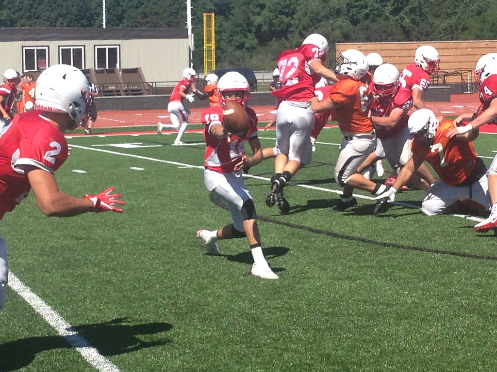. John Kampf - The News-Herald Perry QB Drew Schiano pitches to Cameron Rogers in a scrimmage with North on Aug. 11.