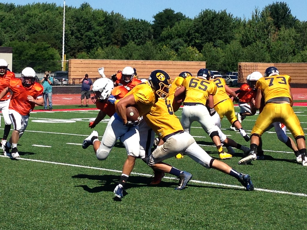 . John Kampf - The News-Herald Kirtland\'s Tommy Powers tries to get around the end in a scrimmage against Eastlake North on Aug. 11