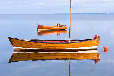 Boat moored in Puck Bay, early evening, Hel Peninsula, Baltic Sea, Poland
