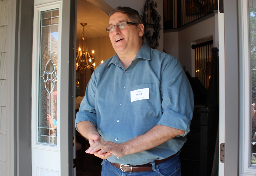 . YMCA Dream House winner Ron Fatica, of Willoughby, stands in the doorway after winning the 2017 Dream House. (Tawana Roberts/The News-Herald)
