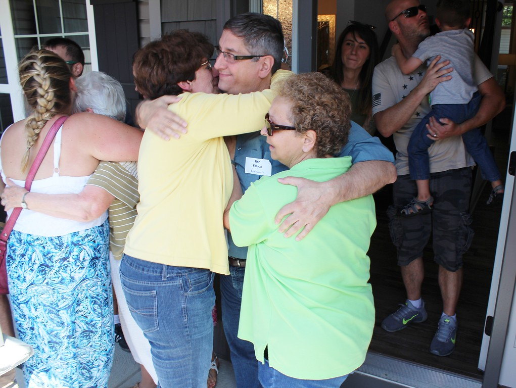 . YMCA Dream House winner Ron Fatica, of Willoughby, gives out hugs after winning the 2017 Dream House. (Tawana Roberts/The News-Herald)